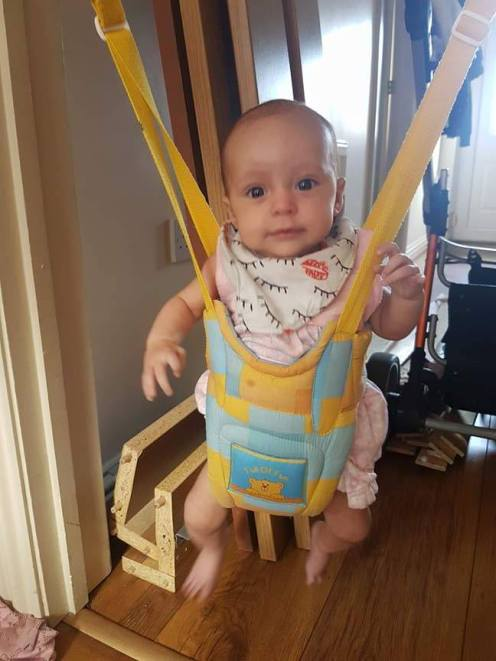 Miyah in her new door bouncer!